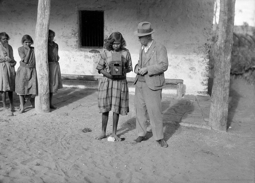 Aboriginal Girl Explores E.O. Hoppe's Camera, Hermannsburg Lutheran Mission Station, Central Australia, 1930