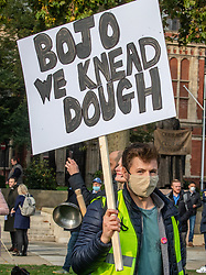 © Licensed to London News Pictures. 19/10/2020. London, UK. A restaurant worker holding a poster demonstrates at a protest by people in the hospitality industry in Parliament Square, London against tougher  Covid restrictions and the amount of financial compensation given to the industry. Today, Wales's First Minister Mark Drakeford has announced a two week 'firebreaker' for Wales with shops, bars, pubs and cafes to closed and people ordered to stay at home from this Friday pilling pressure on Prime Minister Boris Johnson to follow suit in England as coronavirus levels of infections continue to escalate throughout the UK. Photo credit: Alex Lentati/LNP
