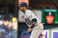Joe Mauer #7 of the Minnesota Twins leads off 1st base during a game against the Detroit Tigers on June 15, 2013 at Target Field in Minneapolis, Minnesota.  The Twins defeated the Tigers 6 to 3.  Photo: Ben Krause