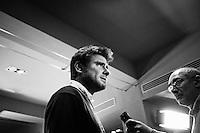 """ROME, ITALY - 25 FEBRUARY 2013: Alessandro Di Battista, a 34 years old journalist candidate with the Five Stars Movement, is interviewed after  being elected in the Chamber of Deputies in the Italian general elections, at the Five Stars Movement press room in Rome, on February 25, 2013.<br /> <br /> A general election to determine the 630 members of the Chamber of Deputies and the 315 elective members of the Senate, the two houses of the Italian parliament, will take place on 24–25 February 2013. The main candidates running for Prime Minister are Pierluigi Bersani (leader of the centre-left coalition """"Italy. Common Good""""), former PM Mario Monti (leader of the centrist coalition """"With Monti for Italy"""") and former PM Silvio Berlusconi (leader of the centre-right coalition).<br /> <br /> ###<br /> <br /> ROMA, ITALIA - 25 FEBBRAIO 2013: Alessandro Di Battista, un giornalista di 34 anni candidato con il Movimento Cinque Stelle, rilascia un'intervista dopo essere stato eletto alla Camera dei Deputati, nella sala stampa del Movimento 5 Stelle a Roma, il 25 febbraio 2013.<br /> <br /> Le elezioni politiche italiane del 2013 per il rinnovo dei due rami del Parlamento italiano – la Camera dei deputati e il Senato della Repubblica – si terranno domenica 24 e lunedì 25 febbraio 2013 a seguito dello scioglimento anticipato delle Camere avvenuto il 22 dicembre 2012, quattro mesi prima della conclusione naturale della XVI Legislatura. I principali candidate per la Presidenza del Consiglio sono Pierluigi Bersani (leader della coalizione di centro-sinistra """"Italia. Bene Comune""""), il premier uscente Mario Monti (leader della coalizione di centro """"Con Monti per l'Italia"""") e l'ex-premier Silvio Berlusconi (leader della coalizione di centro-destra)."""
