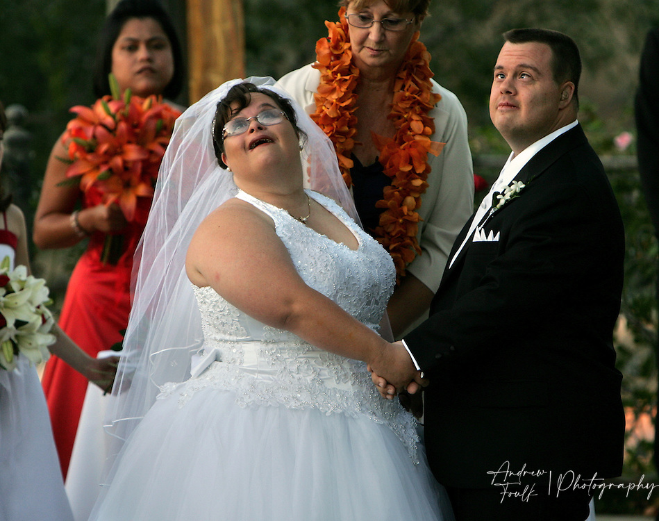 /Andrew Foulk/For The Californian/.Amber Chemello, and Tony Ward, look up at the moon during their wedding ceremony at  Churon Winery in Temecula