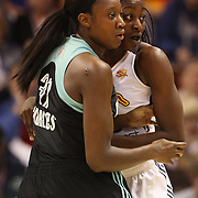 Chiney Ogwumike, (right), Connecticut Sun, the WNBA number one draft pick making her WNBA debut, defends against Tina Charles, New York Liberty and former Sun player during the Connecticut Sun Vs New York Liberty WNBA regular season game at Mohegan Sun Arena, Uncasville, Connecticut, USA. 16th May 2014. Photo Tim Clayton