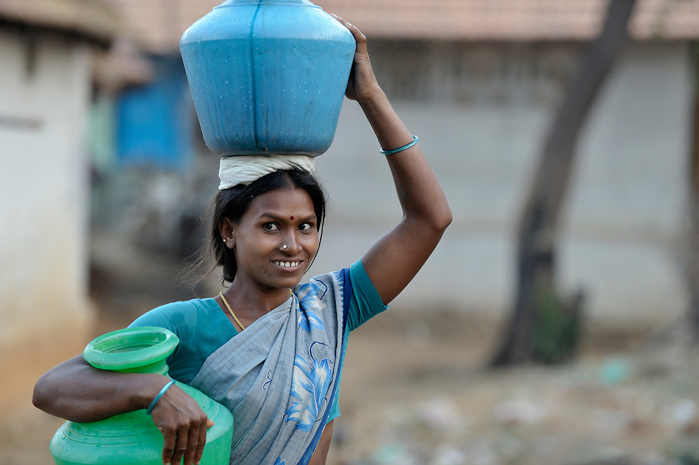 A woman carries water in Nallur, a small village in the state of Tamil Nadu in southern India.