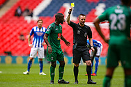 Cray Valley's Paul Semakula (8) receives a yellow card during the FA Vase final match between Chertsey Town and Cray Valley at Wembley Stadium, London, England on 19 May 2019.