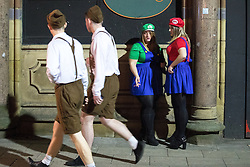 © Licensed to London News Pictures . 27/12/2016 . Wigan , UK . Super Mario Sisters . Revellers in Wigan enjoy Boxing Day drinks and clubbing in Wigan Wallgate . In recent years a tradition has been established in which people go out wearing fancy-dress costumes on Boxing Day night . Photo credit : Joel Goodman/LNP