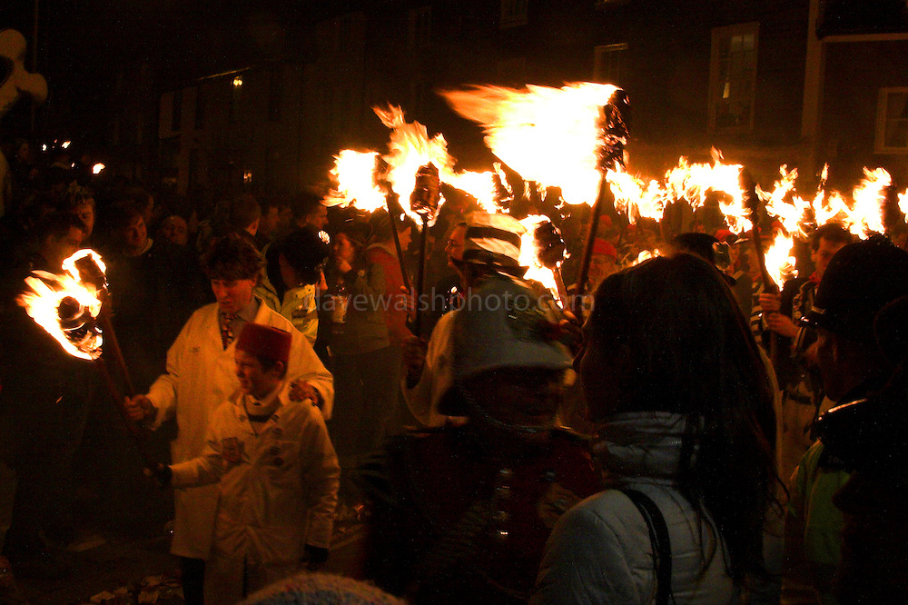 A torchlit procession moves through the streets of Lewes