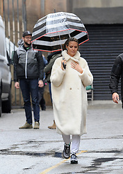 """Model Heidi Klum bundles up in a white coat and carries her own umbrella on the set of """"Germany's Next Top Model"""". 13 Feb 2019 Pictured: Heidi Klum. Photo credit: Pikachu / MEGA TheMegaAgency.com +1 888 505 6342"""