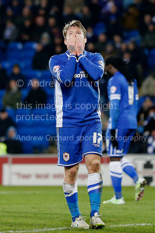 Aron Gunnarsson of Cardiff City looks dejected as he rues his miss.<br /> Skybet football league championship match, Cardiff City v Brighton & Hove Albion at the Cardiff city Stadium in Cardiff, South Wales on Tuesday 10th Feb 2015.<br /> pic by Mark Hawkins, Andrew Orchard sports photography.