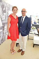 STANLEY TUCCI and his wife FELICITY at the St.Regis International Polo Cup at Cowdray Park, Midhurst, West Sussex on 17th May 2014.