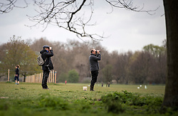 © Licensed to London News Pictures. 03/04/2020. London, UK. Bird spotters in Regents Park in London during a pandemic outbreak of the Coronavirus COVID-19 disease. The public have been told they can only leave their homes when absolutely essential, in an attempt to fight the spread of coronavirus COVID-19 disease. Photo credit: Ben Cawthra/LNP