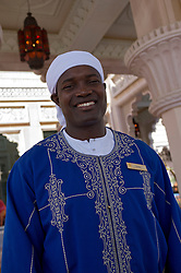 Portrait of doorman at entrance to luxury Al Qasr hotel in Madinat Jumeirah resort complex in Dubai in United Arab Emirates