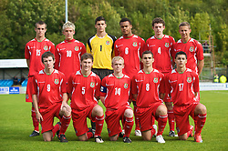 HAVERFORDWEST, WALES - Saturday, October 3, 2009: Wales' players line-up for a team group photograph before the UEFA Under-17 Championship Qualifying Round Group 12 match against Russia at Bridge Meadow Stadium Back row L-R: Richard Peniket, Emyr Huws, goalkeeper Jonathan Bond, Aaron Holloway, Max Penk, Iain Edmunds. Front row L-R: Will James, Ben Davies, captain Jonathan Williams, Jordan Smith, James Loveridge. (Pic by David Rawcliffe/Propaganda)