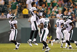 Philadelphia Eagles corner back Nnamdi Asomugha  #24 reacts with Philadelphia Eagles safety Jarrad Page  #25 after Page caught an interception during the preseason game between the Baltimore Ravens and the Philadelphia Eagles. The Eagles won 13-6 at Lincoln Financial Field in Philadelphia, Pennsylvania on Thursday August 11th 2011. (Photo By Brian Garfinkel)