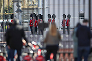People observe a minute's silence outside Buckingham Palace as the Queen's Guards perform the salute in central London on Saturday, April 17, 2021, during the funeral of Prince Philip of the United Kingdom. The Queen announced the death of her beloved husband, His Royal Highness Prince Philip, Duke of Edinburgh who died at age 99. HRH passed away peacefully on April 9th at Windsor Castle after 73 years of marriage to Britain's Queen Elizabeth II. (Photo/ Vudi Xhymshiti)