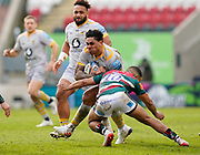 Wasps Centre Malakai Fekitoa is tackled by Leicester Tigers fly-half Zack Henry during a Gallagher Premiership Round 10 Rugby Union match, Friday, Feb. 20, 2021, in Leicester, United Kingdom. (Steve Flynn/Image of Sport)