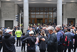 © Licensed to London News Pictures. 03/09/2021. London, UK. Anti Lockdown and anti Covid vaccination protesters  remonstrate with police officers in a demonstration in Cabot Square office in Canary Wharf calling for an end to mandatory vaccination passports and vaccination of teenagers. Photo credit: London News Pictures