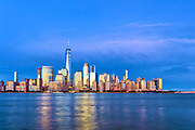 Skyline of Lower Manhattan Financial District and Hudson River, New York City. The skyline of lower downtown Manhattan, New York City, featuring One World Trade Center, the Freedom Tower, by architect David Childs, seen over the Hudson River.