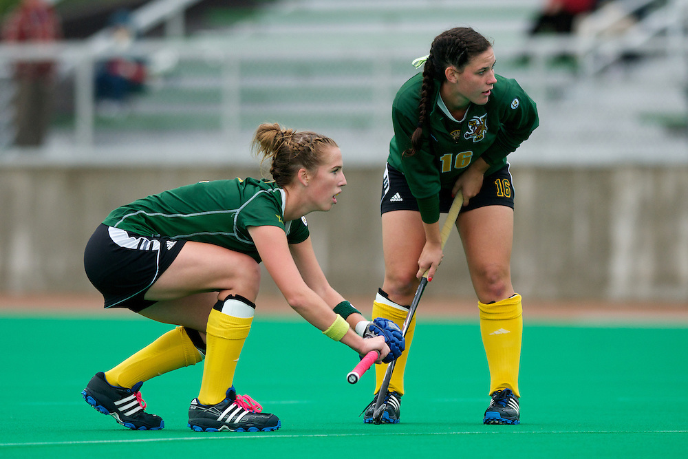 Catamounts midfielder Whitlee Burghardt (2) and Catamounts midfielder Sally Snickenberger (16) wait for a corner pass during the women's field hockey game between the Maine Black Bears and the Vermont Catamounts at Moulton/Winder Field on Saturday afternoon September 29, 2012 in Burlington, Vermont.