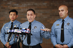 January 30, 2018 - Chicago, IL, USA - Chicago Police officers, Julio Cruz (cq), center, Jason Fong (cq), left, and Raymond Barreto (cq), 3 of 4 officers involved in the rescue of individuals in a house fire yesterday, they are seen here talking to the media at CPD 11th District in  Chicago on Tuesday, Jan. 30, 2018. Chicago Police Officers involved in the rescue of individuals from a residential fire that occurred in the early morning hours of January 29, 2018 on the 3900 block of West Congress will be made available to members of the media at 6:30 AM in the 11th District Station. (Credit Image: © Jose M. Osorio/TNS via ZUMA Wire)