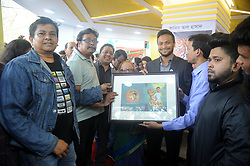 February 5, 2018 - Dhaka, Bangladesh - Bangladeshi Cricketer Shakib Al Hasan (C) hold up with others guest his written a book name is ''Halum'' at Parl Publications stall in Ekushey Book Fair in Dhaka, Bangladesh. On February 5, 2018. (Credit Image: © Str/NurPhoto via ZUMA Press)