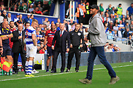Queens Park Rangers manager Ian Holloway looks unimpressed as a pitch-invader is removed during the EFL Sky Bet Championship match between Queens Park Rangers and Burton Albion at the Loftus Road Stadium, London, England on 23 September 2017. Photo by Richard Holmes.