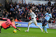 Swansea city's Michu © shoots and scores his sides 4th goal (his 2nd) Barclays Premier league, Swansea city v Queens Park Rangers at the Liberty Stadium in Swansea, South Wales on Saturday  9th Feb 2013. pic by Andrew Orchard, Andrew Orchard sports photography,