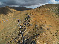 Aerial view of the famous winding mountain road that links the small towns of Casillas del Ángel and Pájara in Fuerteventura, Canary Islands.