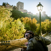 Guitarist playing under Alhambra