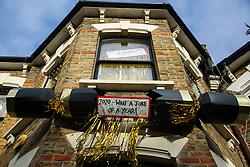 © Licensed to London News Pictures. 16/12/2020. London, UK. A '2020 - What a Joke of a Year!' message inside a giant Christmas cracker installed outside a house in north London, following the year in which the COVID-19 has disrupted lives. Photo credit: Dinendra Haria/LNP
