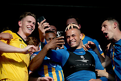 Shrewsbury Town's goalkeeper Dean Henderson (left) Carlton Morris and James Bolton (right) celebrate with a selfie at the end of the Sky Bet League One play-off second leg match at Montgomery Waters Meadow, Shrewsbury.