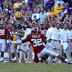 November 6, 2010; Baton Rouge, LA, USA;  LSU Tigers running back Richard Murphy (18) is tackled by Alabama Crimson Tide linebacker C.J. Mosley (32) during the second half at Tiger Stadium. LSU defeated Alabama 24-21.  Mandatory Credit: Derick E. Hingle