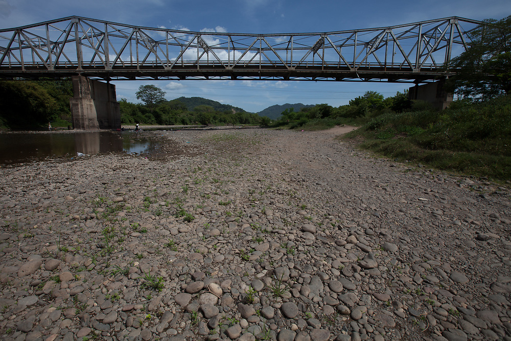 A bridge over the Choluteca River, also known as the Rio Grande. With the prolonged droughts in this region, because of climate change, the river frequently dries up except for ponds on the river bed.