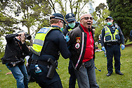 A man is arrested after being told to move on during the Melbourne Freedom Rally at The Shrine. Premier Daniel Andrews promises 'significant' easing of Stage 4 restrictions this weekend. This comes as only one new case of Coronavirus was unearthed over the past 24 hour and no deaths. (Photo by Dave Hewison/Speed Media)