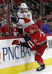 November 7, 2017 - Raleigh, NC, USA - The Carolina Hurricanes' Joakim Nordstrom (42) checks the Florida Panthers' MacKenzie Weegar (52) into the boards during the first period at PNC Arena in Raleigh, N.C., on Tuesday, Nov. 7, 2017. (Credit Image: © Chris Seward/TNS via ZUMA Wire)