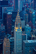 The Chrysler Building is an Art Deco-style skyscraper located on the East Side of Midtown Manhattan in New York City, at the intersection of 42nd Street and Lexington Avenue in the Turtle Bay neighborhood. At 1,046 feet, the structure was the world's tallest building for 11 months before it was surpassed by the Empire State Building in 1931. It is the tallest brick building in the world, albeit with a steel frame. After the destruction of the World Trade Center, it was again the second-tallest building in New York City until December 2007, when the spire was raised on the 1,200-foot Bank of America Tower, pushing the Chrysler Building into third position. In addition, The New York Times Building, which opened in 2007, is exactly level with the Chrysler Building in height. Both buildings were then pushed into fourth position, when the under-construction One World Trade Center surpassed their height, and then to fifth position by 432 Park Avenue which was completed in 2015. The Chrysler Building is a classic example of Art Deco architecture and considered by many contemporary architects to be one of the finest buildings in New York City. In 2007, it was ranked ninth on the List of America's Favorite Architecture by the American Institute of Architects. It was the headquarters of theChrysler Corporation from 1930 until the mid-1950s. Although the building was built and designed specifically for the car manufacturer, the corporation did not pay for the construction of it and never owned it, as Walter P. Chrysler decided to pay for it himself, so that his children could inherit it.