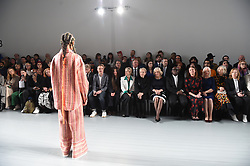 The Duchess of Cornwall (centre right) watches models on the catwalk during a visit to London Fashion Week at the BFC Show Space, London.
