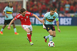LILLE, FRANCE - Friday, July 1, 2016: Wales' Joe Allen in action against Belgium's Eden Hazard during the UEFA Euro 2016 Championship Quarter-Final match at the Stade Pierre Mauroy. (Pic by Paul Greenwood/Propaganda)