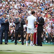 LONDON, ENGLAND - JULY 16: Roger Federer of Switzerland receives his trophy from The Duke of Kent  after the Gentlemen's Singles final of the Wimbledon Lawn Tennis Championships at the All England Lawn Tennis and Croquet Club at Wimbledon on July 16, 2017 in London, England. (Photo by Tim Clayton/Corbis via Getty Images)