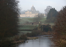 © Licensed to London News Pictures. 06/02/2017. Castle Howard, North Yorkshire, UK.  A walker in the grounds of Castle Howard, North Yorkshire on a cold morning.  Photo credit: Anna Gowthorpe/LNP