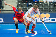 The Netherlands Constantijn Jonker is under pressure by Denis Shchipachev of Russia. Russia v The Netherlands - Unibet EuroHockey Championships, Lee Valley Hockey & Tennis Centre, London, UK on 25 August 2015. Photo: Simon Parker