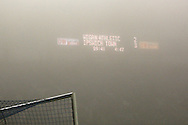 Scoreboard barely visible through the fog during the EFL Sky Bet Championship match between Wigan Athletic and Ipswich Town at the DW Stadium, Wigan, England on 17 December 2016. Photo by Craig Galloway.