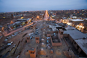 View at dusk of the rooftop of Amir Chakhaq Complex from its highest point. Windtowers called badgirs (Farsi), seen jutting out of the top of the roof catch the wind and cool the building. The domes (called gonbads) Yazd, Iran.
