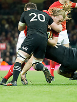 Rugby Union - 2017 Under Armour Series (Autumn Internationals) - Wales vs. New Zealand<br /> <br /> Ken Owens of Wales tackled byn20\& Beauden Barrett of NZ, at The Principality Stadium (Millennium Stadium), Cardiff.<br /> <br /> COLORSPORT/WINSTON BYNORTH
