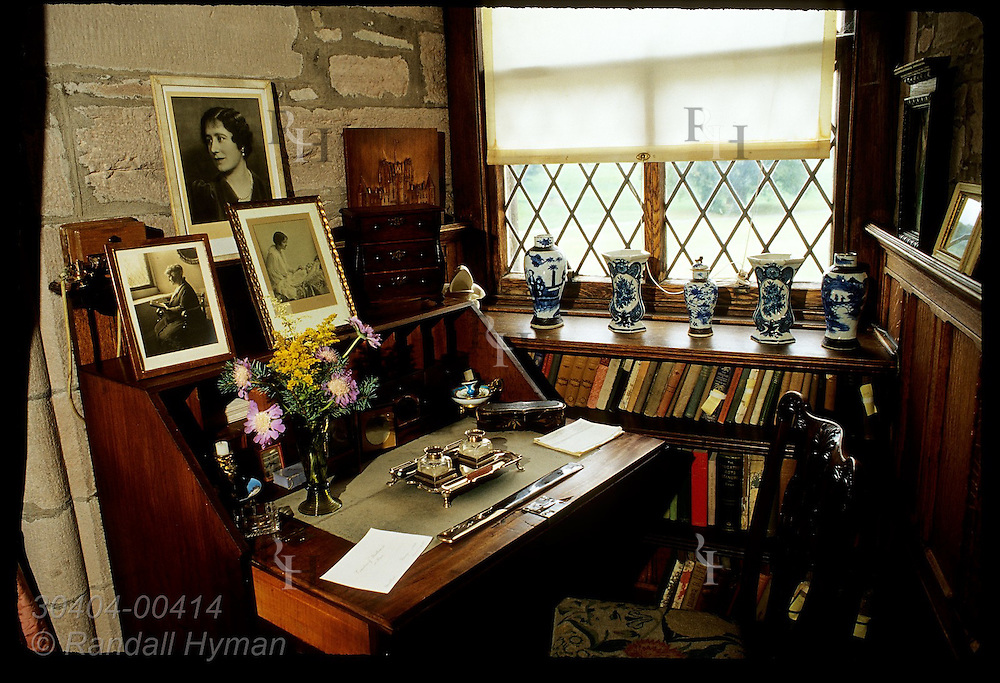Desk in corner of Queen Mother's Sitting Room in Royal Apts features her family portraits and memorabilia; Glamis Castle, Scotland.