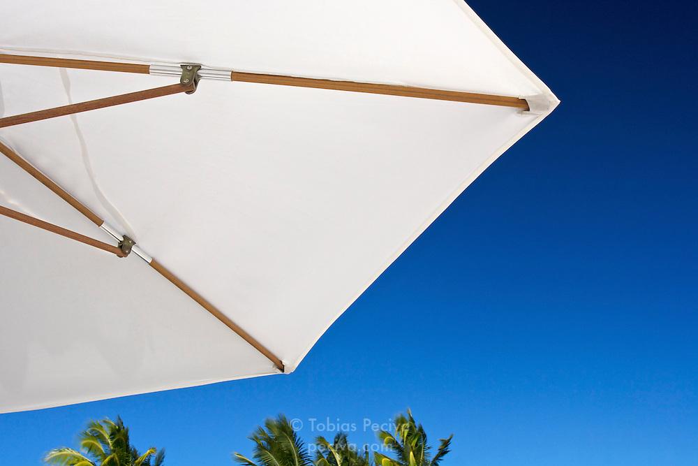Sun umbrella on a Bora Bora beach. Bora Bora is one of the Leeward Islands in the Society Islands archipelago of French Polynesia.