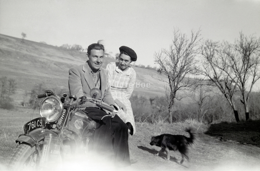 couple posing sitting on a motorcycle early 1960s rural France