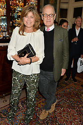JOHN & SARAH STANDING at a party to celebrate the publication of Right or Wrong: The Memoirs of Lord Bell held at Mark's Club, Charles Street, London on 16th October 2014.