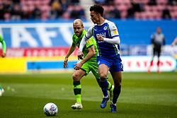 Antonee Robinson of Wigan Athletic takes on Teemu Pukki of Norwich City - Mandatory by-line: Robbie Stephenson/JMP - 14/04/2019 - FOOTBALL - DW Stadium - Wigan, England - Wigan Athletic v Norwich City - Sky Bet Championship
