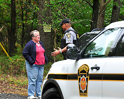 State Police talk with a resident on Beartown Road. Police converge on Barrett Township in the Pocono Mountains in search of ambush suspect Eric Matthew Frein who is accused of shooting two Pennsylvania State Troopers Sept. 25th, 2014 in Canadensis, Pennsylvania (Chris Post | lehighvalleylive.com)