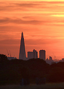 © Licensed to London News Pictures. 18/08/2012. Richmond, UK An early morning sunrise, seen from Richmond Park, over Europe's tallest skyscraper the Shard, London, on Saturday 18 August 2012 as the UK's capital city prepares itself for temperatures of over 30 degrees celsius in what is expected to be one of the hottest August weekends on record. Photo credit : Stephen Simpson/LNP